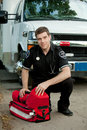 Paramedic with Portable Oxygen Unit Stock Image