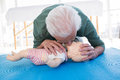 Paramedic practicing resuscitation mouth to mouth on dummy Royalty Free Stock Photo