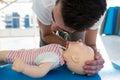 Paramedic practising resuscitation on dummy Royalty Free Stock Photo