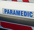 Paramedic sign on an ambulance Royalty Free Stock Photo