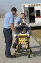 Paramedics Carrying Victim On Stretcher Royalty Free Stock Photo