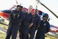 Paramedics And Crew In Front Of Helicopter Royalty Free Stock Photo