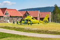 Paramedics helps patient into ambulance helicopter. Royalty Free Stock Photo