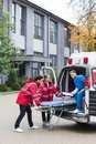 paramedics moving ambulance stretcher Royalty Free Stock Photo