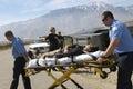 Paramedics Transporting Victim On Stretcher Royalty Free Stock Photo