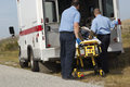 Paramedics With Victim On Stretcher Royalty Free Stock Photo