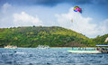 Parasail sport and recreation in thailand is a parachute that will lift a person up into the air when it is towed by a motorboat Stock Images