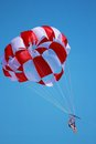 Parasailing girls photo of a chute dragged by boat Stock Images