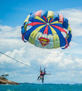 Parasailing happy young couple behind a boat in rayong thailand Royalty Free Stock Image