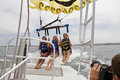 Parasailing over the pacific ocean para sailing has become one of top things for vacationers to do for recreation at front Royalty Free Stock Photos