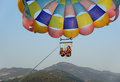 Parasailing two people at summer evening Stock Photo