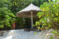 Parasol on the beach sun loungers under a in maldives Royalty Free Stock Photo