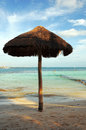 Parasol on caribbean beach of mexico Stock Photo
