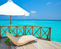 Parasol and chaise lounges Royalty Free Stock Photo