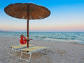 Parasol at dawn beach chairs and in alghero Royalty Free Stock Photos