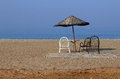 Parasol and a few chairs on the beach against the sea turkey Royalty Free Stock Image