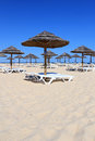 Parasol and sun loungers on Algarve beach Stock Image