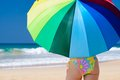 Parasol young woman with on a sunny seashore Royalty Free Stock Photo