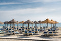 Parasols with deckchairs on the beach nerja spain Stock Image