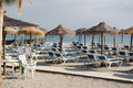 Parasols with deckchairs on the beach nerja spain Stock Photography