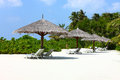 Parasols on Maldives beach Stock Image