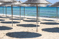 Parasols and shades on sea beach in sunny day Royalty Free Stock Photography