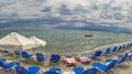 Parasols at summer beach panorama Royalty Free Stock Photo