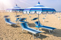 Parasols and sunbeds at rimini beach italy italian summer Stock Photo