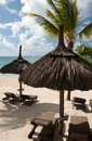 Parasols on tropical beach with mauritius Royalty Free Stock Images