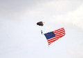 A paratrooper with the american flag special forces unfurls to start air show at linder regional airport in lakeland florida Stock Image
