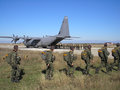 Paratroopers bulgarian headed for a training jump with a us c hercules Stock Photography