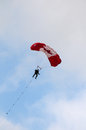 Paratroopers descent stock image lookup shot of a paratrooper overflying Royalty Free Stock Photo