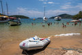 Paraty bay tropical beach boats and tourists enjoying the clear transparent green waters of a in rio de janeiro brazil Royalty Free Stock Photography