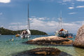 Paraty bay tropical beach a large rock in the clear waters of a in three sailing boats and the transparent green waters rio de Stock Images