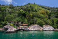 Paraty bay tropical beach large rocks a marina the clear transparent green waters of a in and the forest rio de janeiro brazil Royalty Free Stock Photos