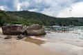 Paraty beach rio de janeiro brazil fishing boats and large rocks on a in an island of bay Stock Photography