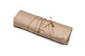 Parcel package wrapped with brown kraft paper tied rope isolated on white Royalty Free Stock Image