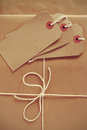 Parcel packing brown paper labels and string Royalty Free Stock Photo