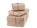 Parcel wrapped with brown kraft paper isolated on white backgrou background Royalty Free Stock Photography