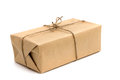 Parcels box wrapped with kraft paper isolated on white Royalty Free Stock Photo