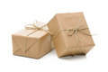 Parcels wrapped with brown paper group of and tied string isolated on white background Royalty Free Stock Photos