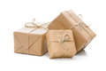 Parcels wrapped with brown paper group of and tied string isolated on white background Stock Photos