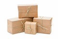 Parcels wrapped with brown paper group of and tied string isolated on white background Stock Image