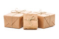 Parcels wrapped with brown paper group of and tied string isolated on white background Stock Images