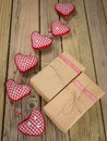 Parcels wrapped in brown paper and string with red check hearts