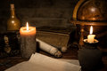 Parchment paper, a old globe and candles, a old book and a woode Royalty Free Stock Photo