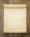 Parchment scroll on wood background Royalty Free Stock Photography