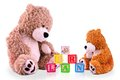 Parent and child bear at learning alphabets Royalty Free Stock Photo