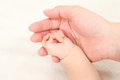 Parent and child holding hands Stock Images