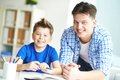 Parent and child photo of happy men his son looking at camera at home Stock Images